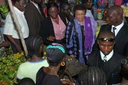 President Sirleaf being taken on a guided tour of the Nancy B. Doe market